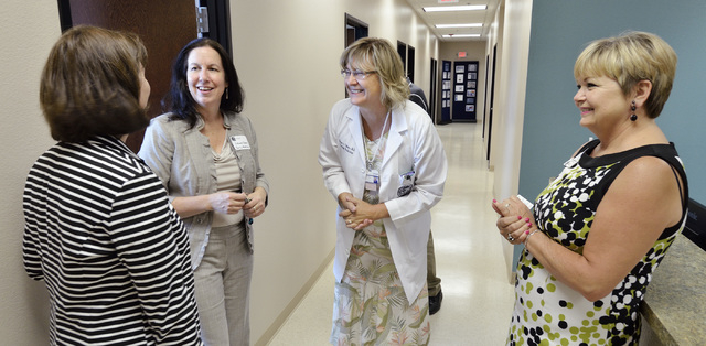 Dr. Elissa Palmer, center, talks with, from left, Marica Turner, Ph.D., Dr. Laura Shaw and Richelle O'Driscoll during the grand opening of the Patient Care Center operated by the University of Nev ...