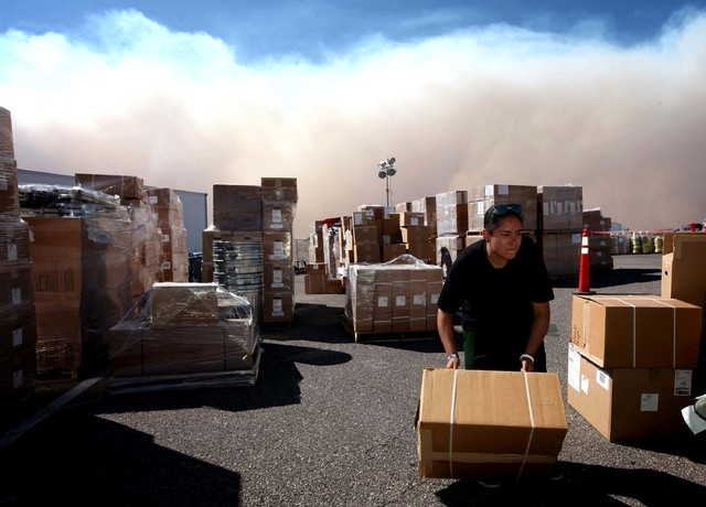 Indiara Modesto works outside in the supply unit area at Centennial High School, the Carpenter 1 fire command center, in Las Vegas on Monday, July 8, 2013. The wildfire, which encompasses thousand ...