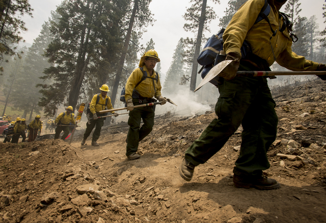 A Type 2 firefighters from Sequoia National Forest heads back to fight the Carpenter 1 Fire after a break at  the Rainbow subdivision in Mt. Charleston on Tuesday, July 9, 2013. The lighting cause ...