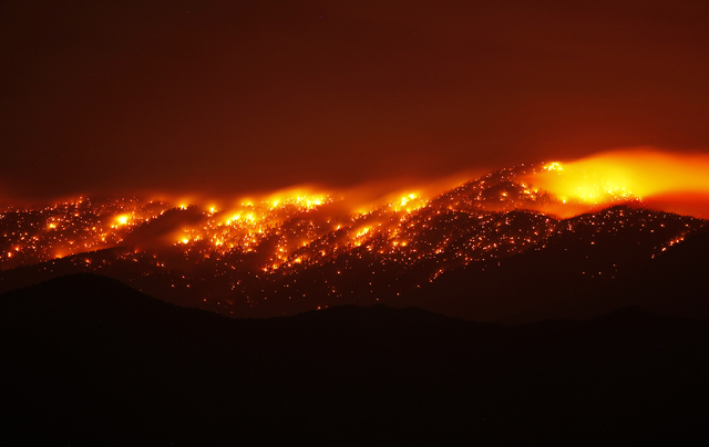 The Carpenter 1 burns on Mount Charleston outside of Pahrump early in the morning on Saturday, July 6, 2013. Fire restrictions are now in effect for several recreational areas surrounding the Las  ...