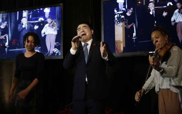 Recycling magnate Chen Guangbiao sings to the media and his guests from the  New York City Rescue Mission at The Loeb Boathouse restaurant in New York, Wednesday, June 25, 2014. The Chinese tycoon ...