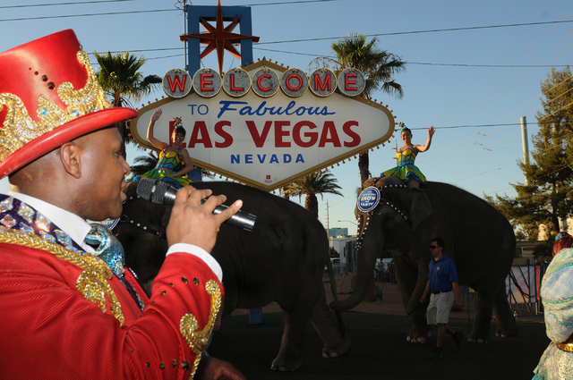 """Ring Master Johnathan Lee Iverson addresses audience members during their welcoming event at the """"Welcome to Fabulous Las Vegas"""" sign Wednesday, June 18, 2014. (Erik Verduzco/Las Vegas R ..."""