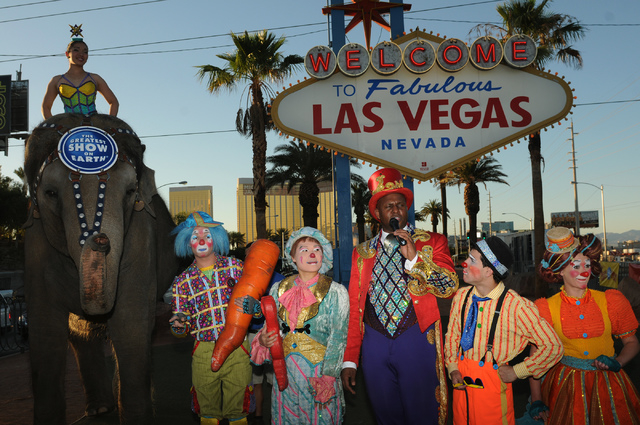 """Performers with Ringling Bros. and Barnum & Bailey circus  address the audience during their welcoming event at the """"Welcome to Fabulous Las Vegas"""" sign Wednesday, June 18, 2014. (Erik V ..."""
