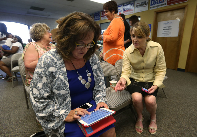 State Sen. Debbie Smith, D-Sparks, left, and Treasurer Kate Marshall watch primary election results at the Washoe County Democratic Party headquarters in Reno, Nev., on Tuesday, June 10, 2014. (La ...