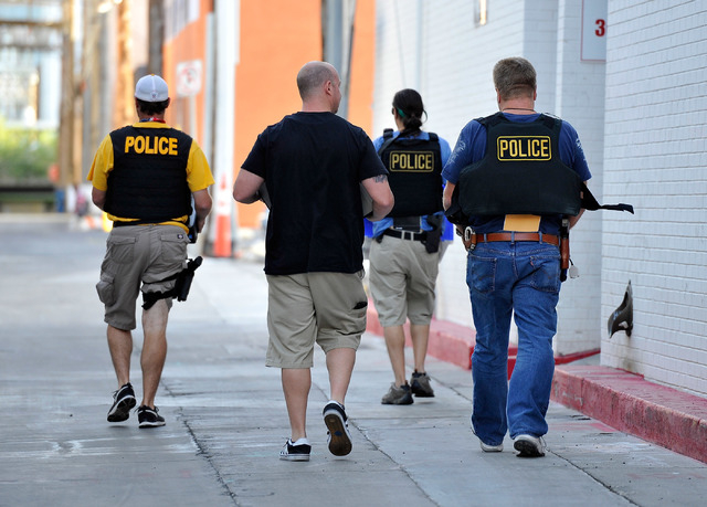 Las Vegas police carry computers and other electronic equipment after serving a search warrant at the Las Vegas Constable office on Tuesday, June 17, 2014. Las Vegas police criminal intelligence s ...