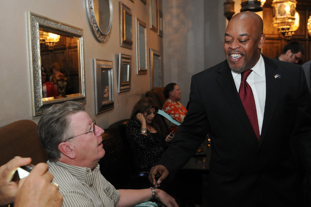 Republican Congressional District 4 candidate Niger Innis, right, greets his supporter Robert Booth during his election night party at Mundo restaurant in Las Vegas Tuesday, June 10, 2014. (Erik V ...