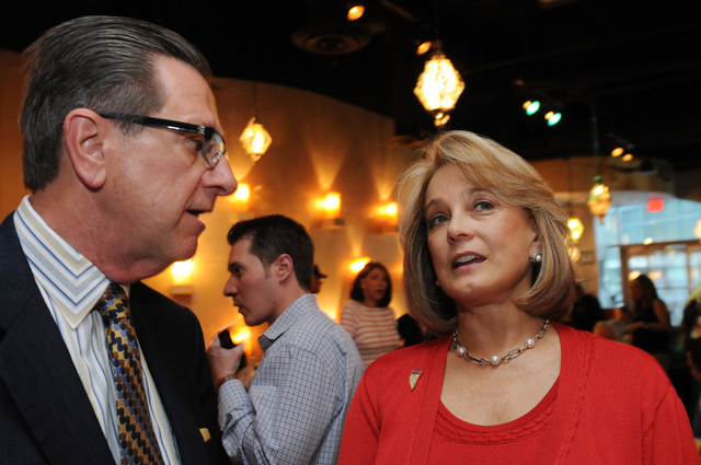 Republican lieutenant governor candidate Sue Lowden, right, speaks with her campaign manager Tom Letizia during her election night party at Mundo restaurant in Las Vegas Tuesday, June 10, 2014. (E ...