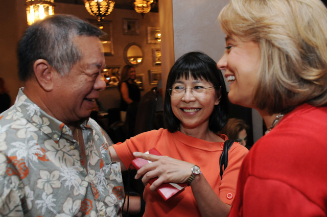 Republican lieutenant governor candidate Sue Lowden, from right, greets her supporters Hui-Lim Ang and Robert Lum during her election night party at Mundo restaurant in Las Vegas Tuesday, June 10, ...