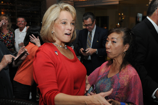 Republican lieutenant governor candidate Sue Lowden, left, greets her supporter Jasmine Guo during her election night party at Mundo restaurant in Las Vegas Tuesday, June 10, 2014. (Erik Verduzco/ ...