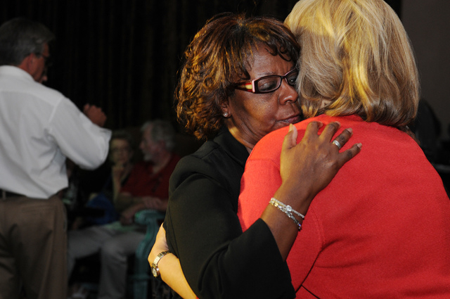 Republican lieutenant governor candidate Sue Lowden, right, is embraced by her supporter Brenda Flank after conceding her race against her opponent at her election night party at Mundo restaurant  ...