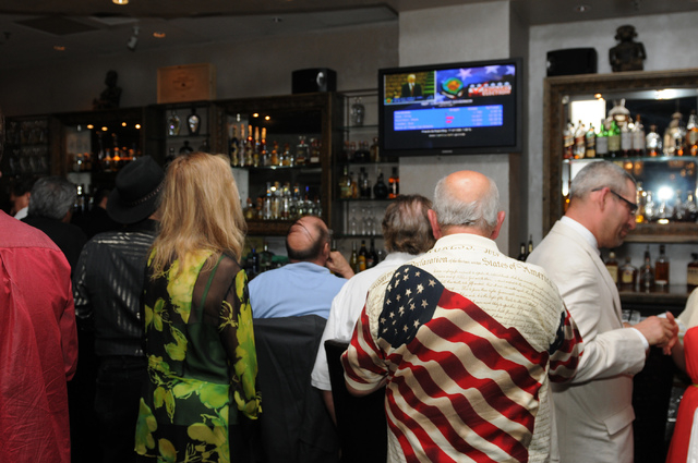People watch primary results on a television at Mundo restaurant in Las Vegas Tuesday, June 10, 2014. (Erik Verduzco/Las Vegas Review-Journal)