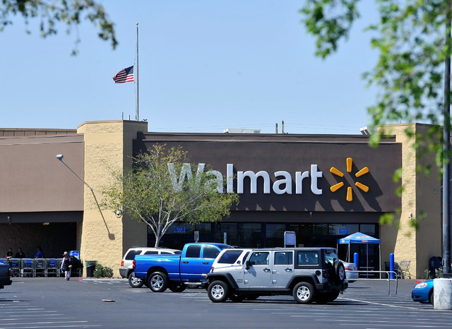 An American flag flies at half mast at the closed Walmart store at 201 N. Nellis Blvd. on Monday, June 9, 2014. The store was the scene of a police shoot out with Jerad Miller and his wife, Amanda ...