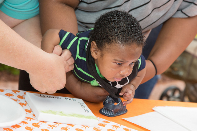 Parents create art work using their baby's hand prints May 7 to celebrate St. Rose Dominican Hospitals San Martin campus, 8280 W. Warm Springs Road, receiving its baby-friendly designation by the  ...