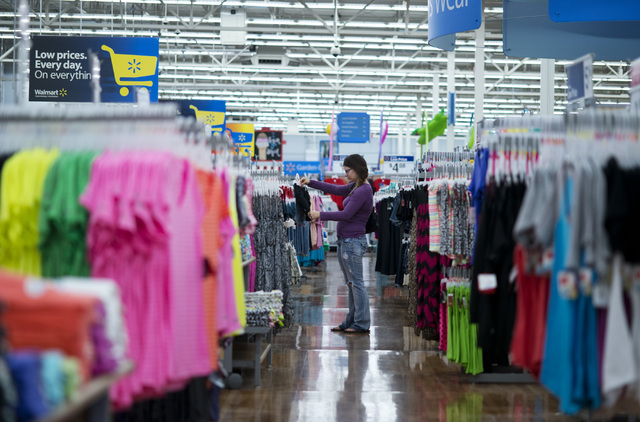 In this June 5, 2014 photo, Chelsea Vick shops for clothes at Wal-Mart Supercenter in Rogers, Ark. The Commerce Department releases retail sales data for May on Thursday, June 12, 2014. (AP Photo/ ...