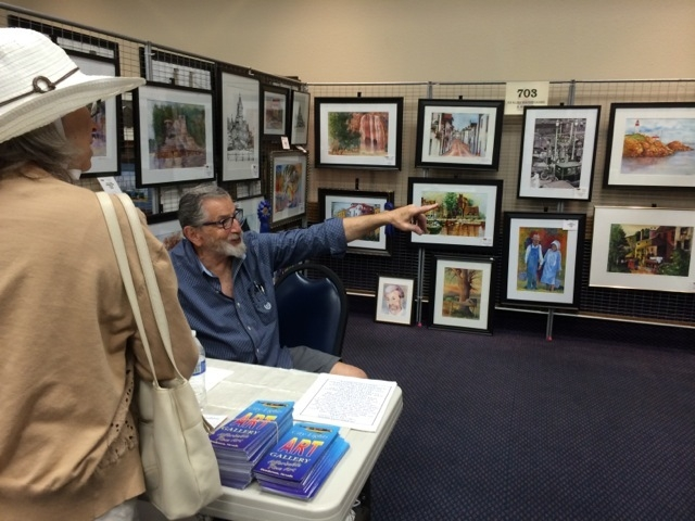 Ed Klein, the president of the City Lights Art Gallery, talks to a customer about the gallery, (Special to View)