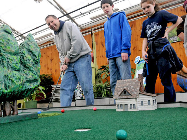 Springs Preserve visitors play indoor miniature golf, set to be offered through Sept. 1 at the facility, 333 S. Valley View Blvd. (Special to View)