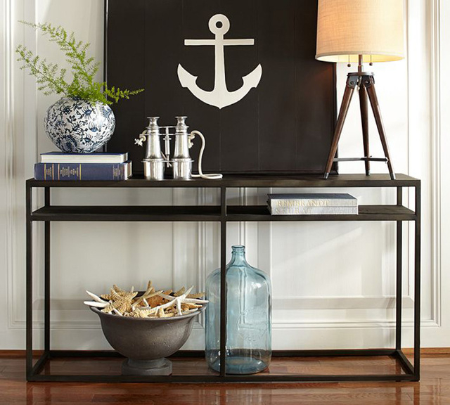 Courtesy photo Crafted from blackened iron in simple cube shapes, Pottery Barn's Burke tables have the bold character of industrial fixtures. The console table functions as a media stand or displa ...