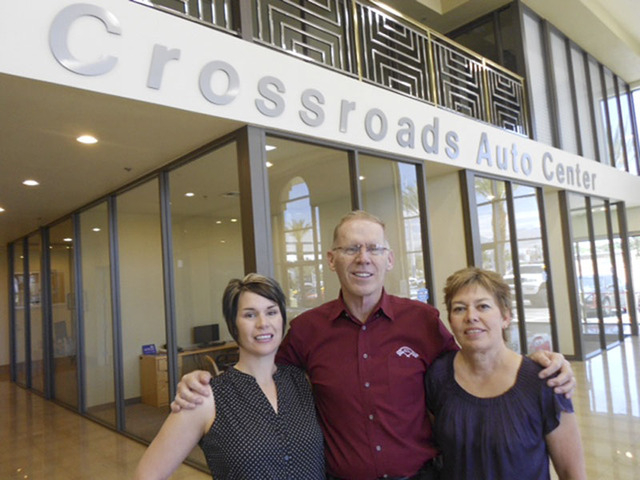 Courtesy photo The family-owned Crossroads Auto Center is owned by Sarah, left, David and Cindy Freeman. The dealership is at 6175 W. Sahara Ave. in the southwest valley.