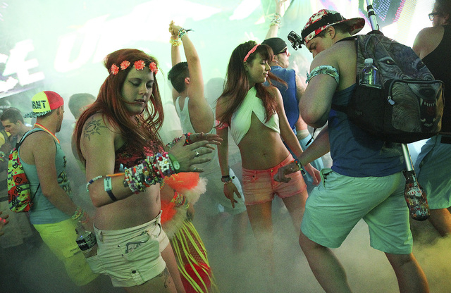Attendees dance as Tommie Sunshine performs at Stage 7 at the Electric Daisy Carnival at the Las Vegas Motor Speedway in Las Vegas on Friday, June 20, 2014. (Chase Stevens/Las Vegas Review-Journal)