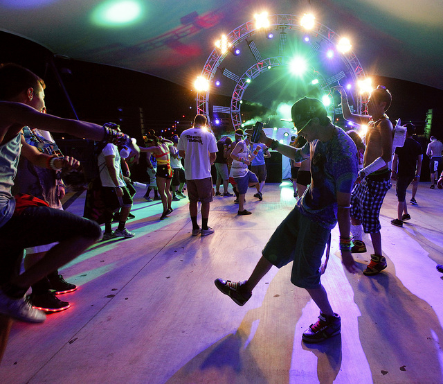 Attendees dance at the Discovery Stage at the Electric Daisy Carnival at the Las Vegas Motor Speedway in Las Vegas on Friday, June 20, 2014. (Chase Stevens/Las Vegas Review-Journal)