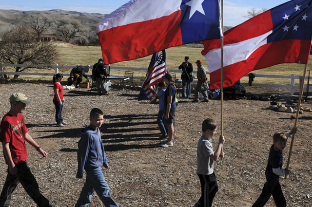 Civil War re-enactment participants practice marching while carrying flags at Spring Mountain Ranch State Park in January 2014. (Erik Verduzco/View file photo)