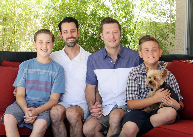 Arron Benson, second from left, sits with his sons Blake, 13, left, and Evan, 10, and his partner John Constantino in the family's backyard with their dog Jackson. Arron and John plan to get mar ...