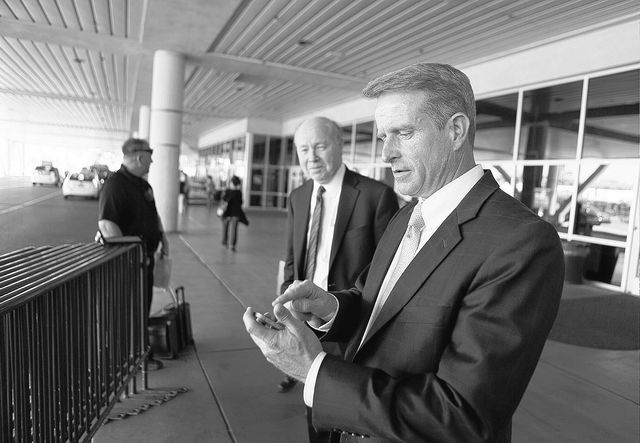 Attorney Christopher Austin, right, makes a phone call outside the National Hardware Show at Las Vegas Convention Center Thursday, May 8, 2014. Attorney Peter Jansson stands nearby. A team led by  ...