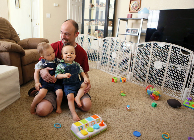 Kevin Zelenka sits with his 16-month-old twins Gavin, left, and Carter in his home Wednesday, May 28, 2014, in Las Vegas. Zelenka is a stay-at-home dad and writes on his blog doulbetroubledaddy.co ...