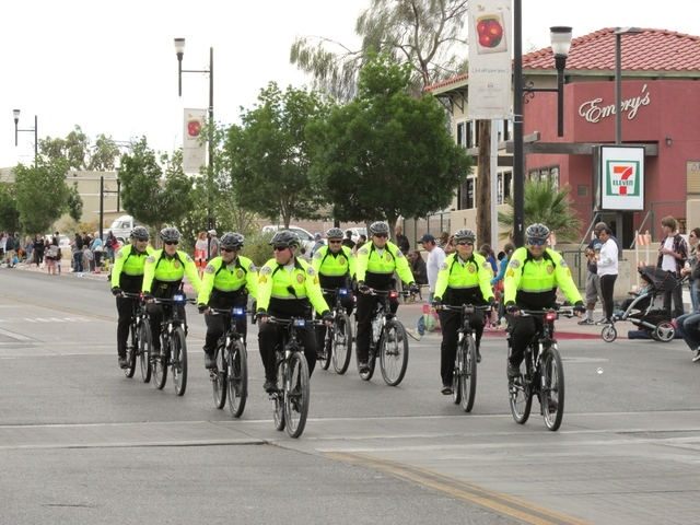 Members of the city of Henderson bicycle unit participate in a parade. (Special to View)