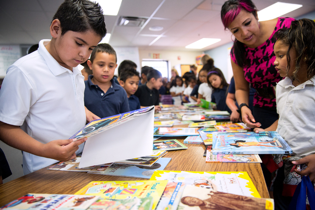 Vegas Verdes Elementary School second-grader Ismael Soto picks a book during a book donation event May 28.  (Samantha Clemens-Kerbs/View)