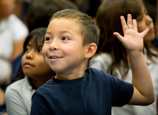 Vegas Verdes Elementary School kindergartner Wilber Cortez raises his hand when asked if he likes to read during a Spread the Word Nevada book donation event. (Samantha Clemens-Kerbs/View)