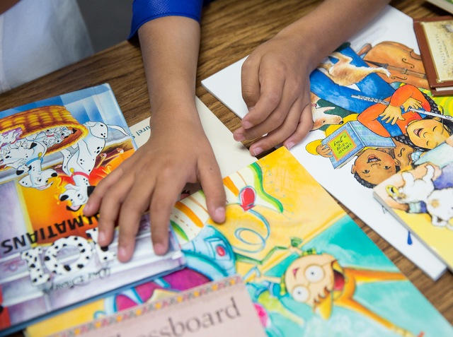 A Vegas Verdes Elementary student picks a book during a Spread the Word Nevada book donation event at the school. (Samantha Clemens-Kerbs/View)