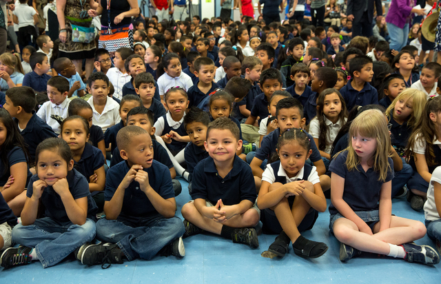 Vegas Verdes Elementary School students wait for an assembly to start May 28. Nonprofit Spread the Word Nevada announced to the students that they would receive five donated books and then one add ...