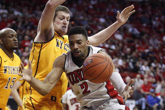 Khem Birch of UNLV grabs a rebound against Wyoming in the Mountain West tournament quarterfinals at the Thomas & Mack Center in Las Vegas on March 13, 2014. The 6-foot-9-inch power forward is expe ...