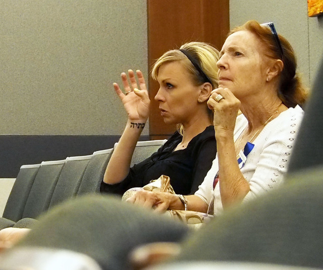 Amber McDearmon, left, sits with an unidentified woman before pleading guilty to a courthouse counseling scheme in Judge Lee Gates courtroom in the Regional Justice Center in Las Vegas, Wednesday, ...