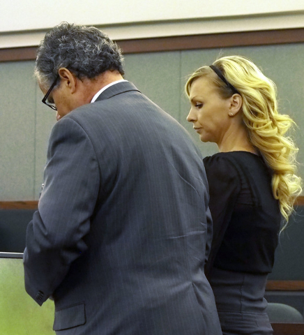 Amber McDearmon stands with her attorney Osvaldo Fumo as she pleads guilty to a courthouse counseling scheme in Judge Lee Gates courtroom in the Regional Justice Center in Las Vegas, Wednesday, Ju ...