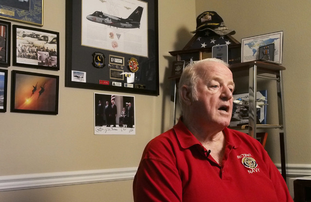 Veteran and history buff Ron Deanne reflects on the 70th anniversary of the D-Day invasion at his home in Henderson, Friday, May 9, 2014. He will observe the event in and around Normandy, France b ...