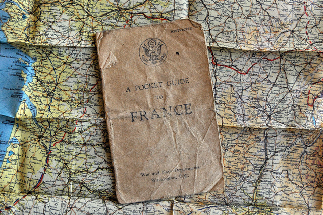 A pocket guide to France during World Ward II is pictured with an Army issued fabric map of France on Wednesday, June 4, 2014. (David Becker/Las Vegas Review-Journal)
