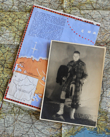 An undated photo of Army Pvt. Ed Jennings dressed in a Scottish kilt, while stationed in the United Kingdom during World Ward II, is pictured on top of an Army issued map of France on Wednesday, J ...