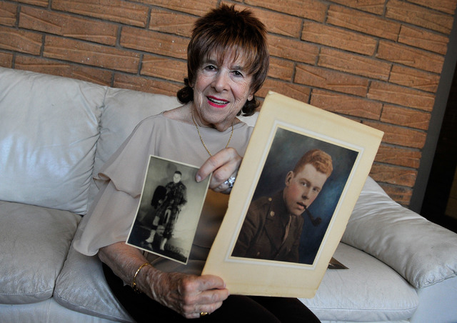 Fern Jennings displays undated photos of her late husband, Army Pvt. Edward Jennings, during World War II on Wednesday, June 4, 2014.  Fern Jennings compiled letters written from Edward to his mot ...