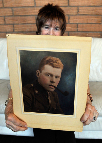 Fern Jennings displays an undated service photo of her late husband, Army Pvt. Edward Jennings, during World War II on Wednesday, June 4, 2014.  Fern Jennings compiled letters written from Edward  ...