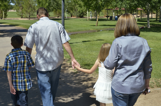 Eric Vollmer, second from left, walks to a playground with his son Colin, daughter Makayla and wife Shawna at Veterans Memorial Park on Commons Way in Boulder City on Tuesday, June 3, 2014. (Bill  ...