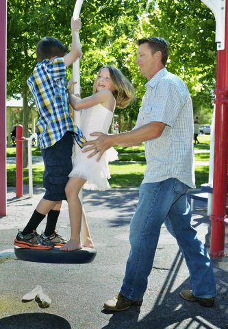 Eric Vollmer, right, is shown with his son Colin and daughter Makayla at a playground at Veterans Memorial Park on Commons Way in Boulder City on Tuesday, June 3, 2014. (Bill Hughes/Las Vegas Revi ...