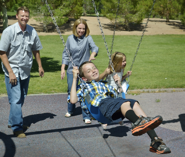 Eric Vollmer, left, is shown with his wife Shawna, son Colin and daughter Makayla at a playground at Veterans Memorial Park on Commons Way in Boulder City on Tuesday, June 3, 2014. (Bill Hughes/La ...