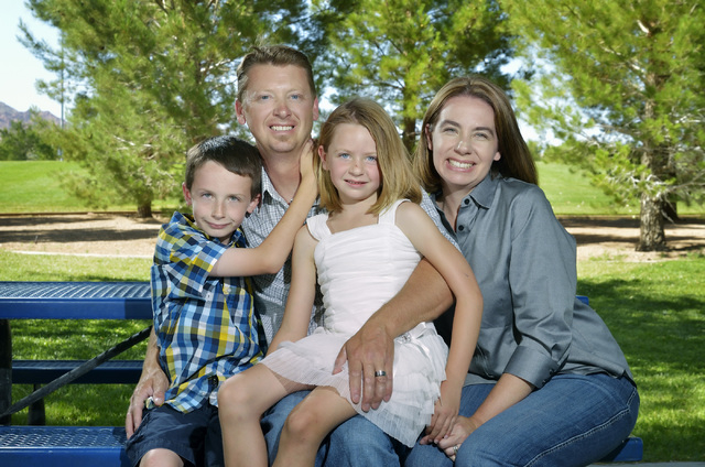 Eric Vollmer, second from left, is shown with his son Colin, daughter Makayla and wife Shawna at a playground at Veterans Memorial Park on Commons Way in Boulder City on Tuesday, June 3, 2014. (Bi ...