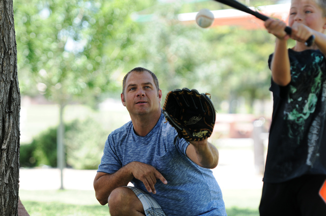 Christopher Beaumont, center, plays baseball with his son Tre, 9, at Sunset Park in Las Vegas Saturday, May 31, 2014. Beaumont, a single father, is an organizer for Single Parents of Las Vegas whe ...