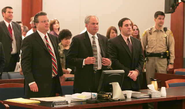 Defense attorneys David Chesnoff, left, and Scott Freeman stand with their client, Darren Mack, right, in Reno court on Oct. 24, 2007, during Mack's murder trial. Mack pleaded guilty to murdering  ...