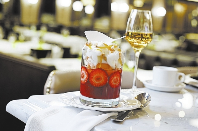 Strawberry–Melon Sundae at DB Brasserie, The Venetian: Strawberries are served with melon sorbet, topped by almond foam and an almond sable. (Courtesy, Bill Milne)