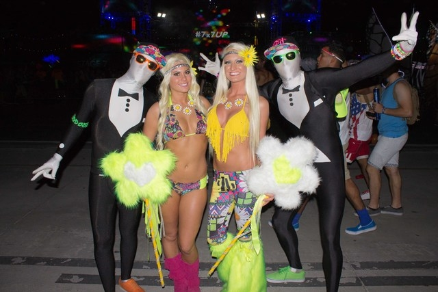"Megan Demello and Renee Bollier built their ""flower power"" costumes over the course of a year and pose at the Electric Daisy Carnival on Friday, June 20. (Kristen DeSilva/Las Vegas Review-Journal)"