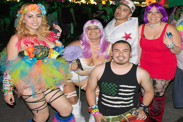 A group shows off their costumes at the Electric Daisy Carnival on Friday, June 20. (Kristen DeSilva/Las Vegas Review-Journal)